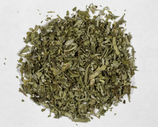 A top down photograph of a small pile of cut and sifted Turnera Diffusa (Damiana) herb.